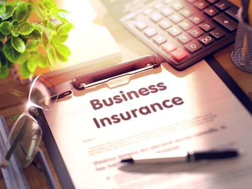 business insurance written out of paper on a clipboard