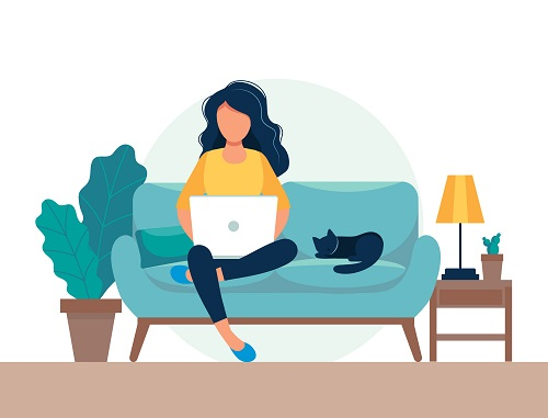 woman sitting on couch with laptop next to cat